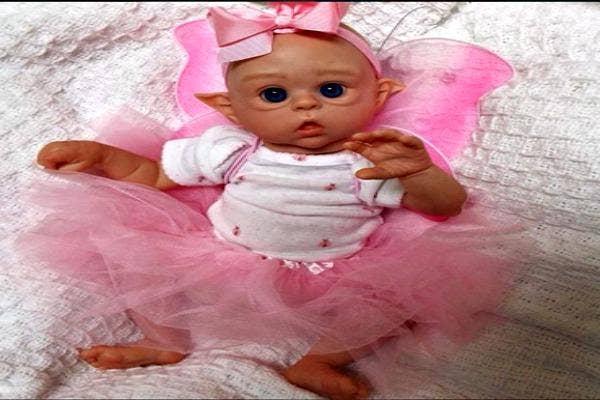 Elf baby in pink.