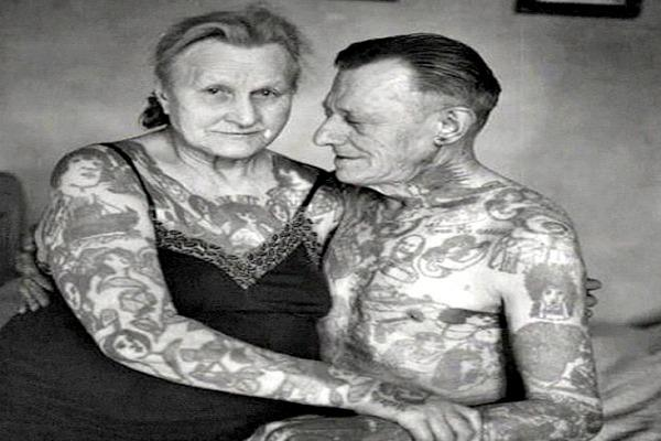 Older couple with a lot of tattoos.