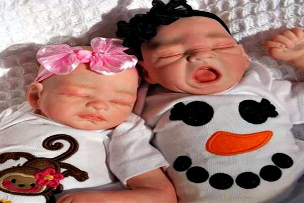 Two babies taking a nap.