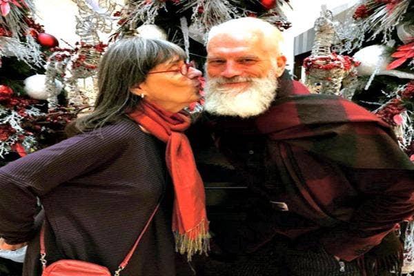 Woman kissing Santa.