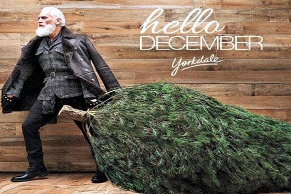 Santa dragging a tree.