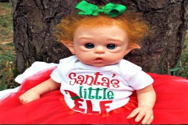 Elf baby in tee shirt.