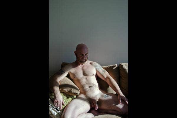 Tattooed naked man.