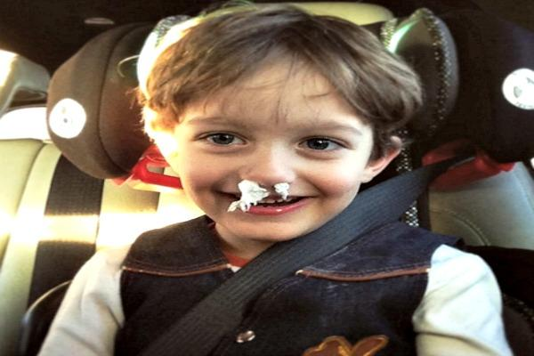 Kid with Kleenex in his nose.