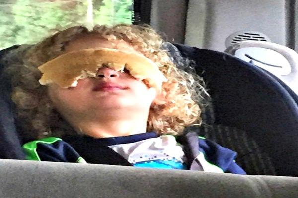 Kid with pancakes on his eyes.
