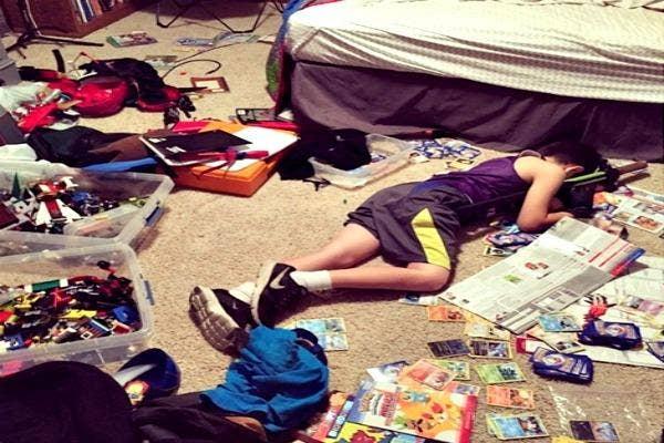 Kid asleep on floor.