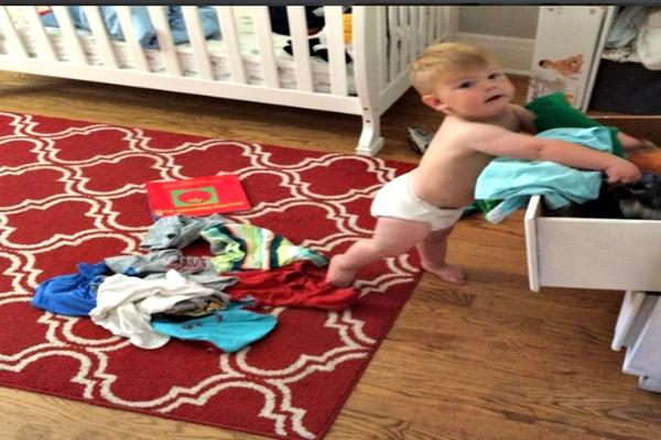 Baby pulling things out of drawers.