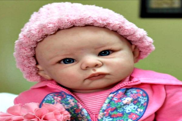 Baby doll in pink hat.