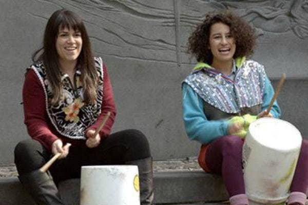 Abbi and Ilana play bucket drums
