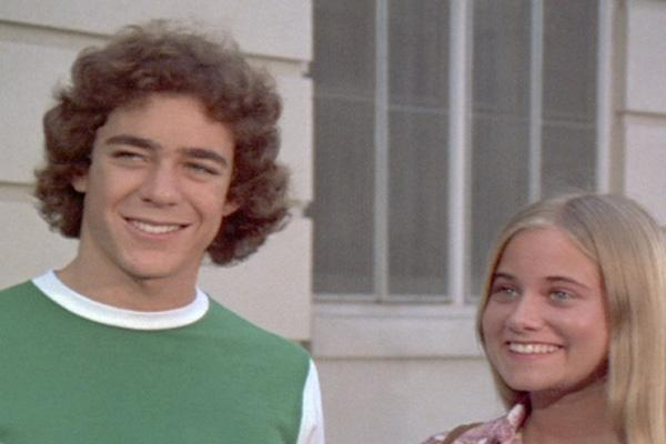 Barry Williams and Maureen McCormick as Greg Brady and Marcia Brady on the Brady Bunch