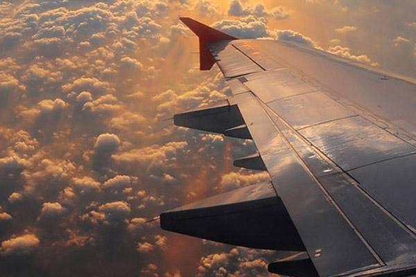 destination wedding, wedding, weddings, airplane, airplane flight, flight, airplane in the air, airline, travel, traveling, bridesmaid, bridal party
