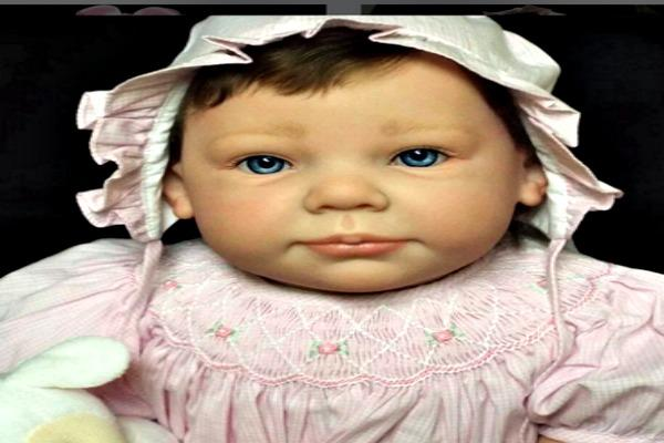 Old fashioned looking doll.