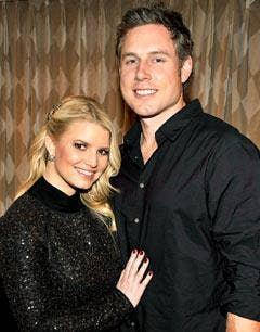 """<a href=""""http://www.usmagazine.com/celebrity-news/news/jessica-simpson-eric-postpone-wedding-2011289"""">usmagazine.com</a>"""