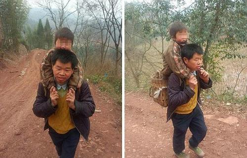 """<a href=""""http://www.dailymail.co.uk/news/article-2577520/The-devoted-Chinese-father-carries-son-18-MILES-school-day-Sichuan-province.html"""" target=""""_blank"""">dailymail.co.uk</a>"""