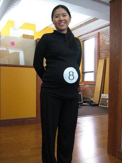 """<a href=""""http://lilaccitymomma.com/2011/10/pregnancy-halloween-costume-idea/"""">lilaccitymomma.com</a>"""