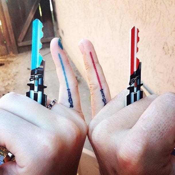 Matching lightsaber best friends tattoo