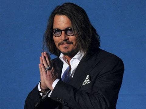 """<a href=""""http://www.imdb.com/media/rm2398859264/nm0000136?ref_=nm_phs_md_3""""/>Johnny Depp - IMDB</a>"""