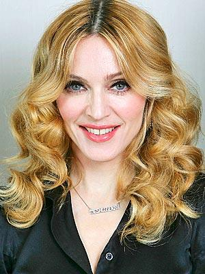 "<a href=""http://www.people.com/people/madonna/"">people.com</a>"