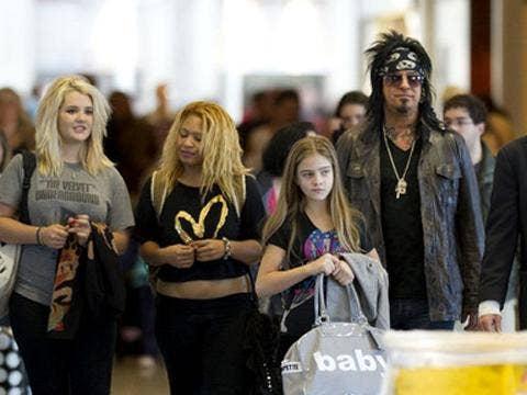 "<a href=""http://www3.pictures.zimbio.com/bg/Nikki+Sixx+Nikki+Sixx+Daughters+LAX+n8nI-AJpR3Al.jpg""/>Nikki Sixx and his daughters, including Storm Brieann Sixx</a>"