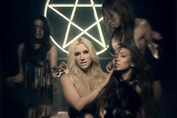 Kesha in the Die Young video with Illuminati and occult imagery
