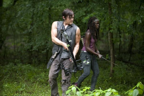 Danai Gurira as Michonne with her sword / katana and Norman Reedus as Daryl Dixon with his crossbow from The Walking Dead AMC to kill zombies and walkers