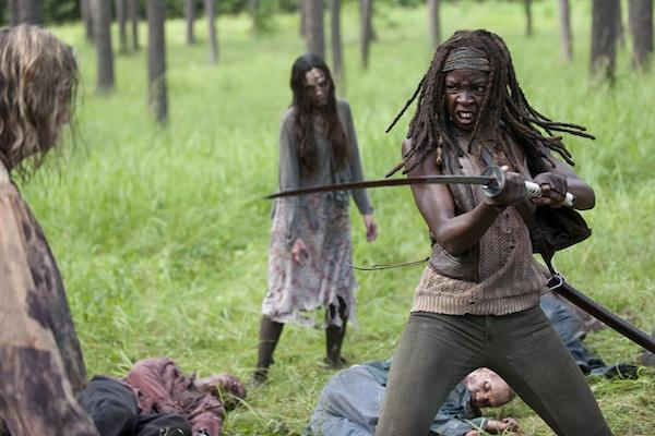 Danai Gurira as Michonne from The Walking Dead AMC killing walkers and zombies with a sword / katana