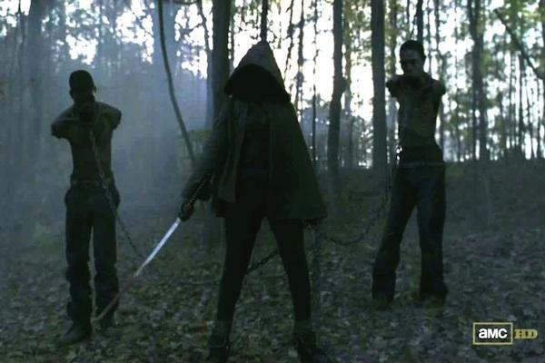 Danai Gurira as Michonne from The Walking Dead AMC with her pet zombies on chains and her sword / katana