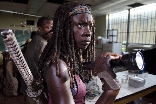 Danai Gurira as Michonne from The Walking Dead AMC holding her sword / katana