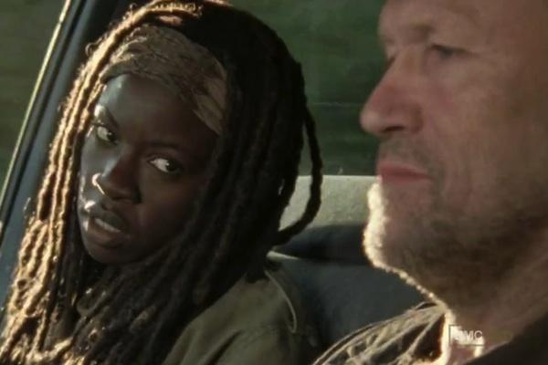 Danai Gurira as Michonne and Michael Rooker as Merle Dixon from The Walking Dead AMC in a car when Merle kidnaps Michonne to take her to The Governor of Woodbury Phillip Blake (Brian Blake)