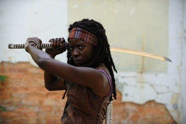 Danai Gurira as Michonne from The Walking Dead AMC wielding her sword / katana to kill zombies and walkers