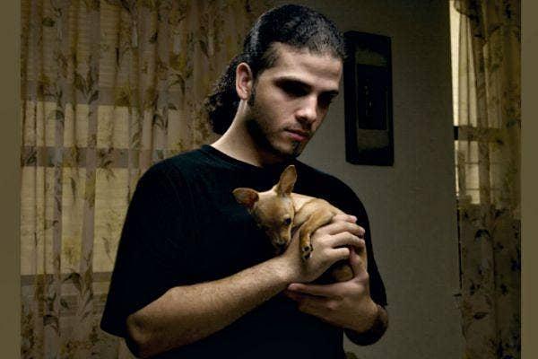 Man with tiny dog.