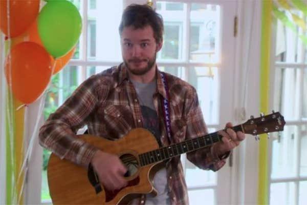 Chris Pratt playing guitar and singing