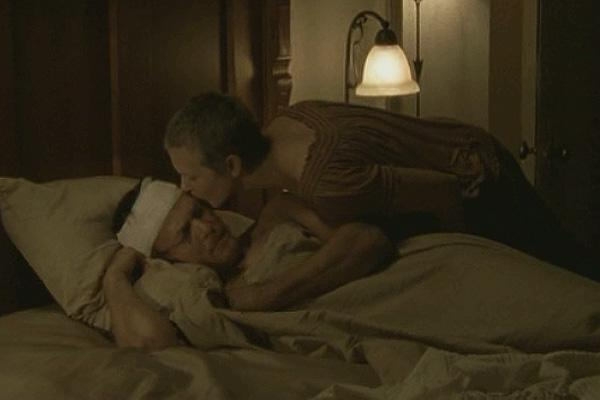 Norman Reedus as Daryl Dixon and Melissa McBride as Carol Pelletier on The Walking Dead after Daryl is shot by dumbass Andrea AMC