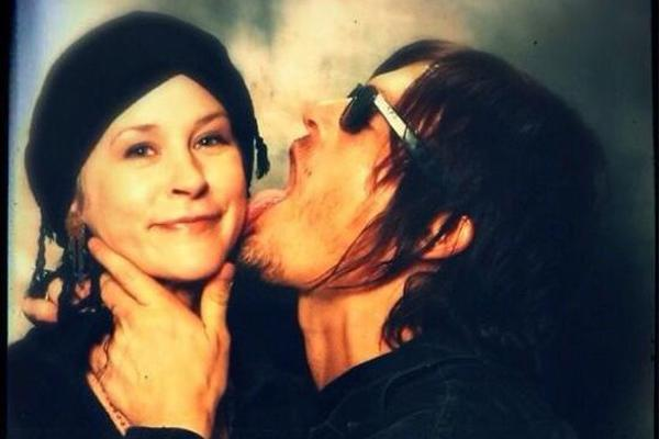 AMC The Walking Dead Melissa McBride as Carol Pelletier and Norman Reedus as Daryl Dixon licking her face