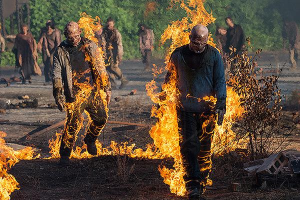 Melissa McBride as Carol Pelletier on The Walking Dead AMC with zombies on fire