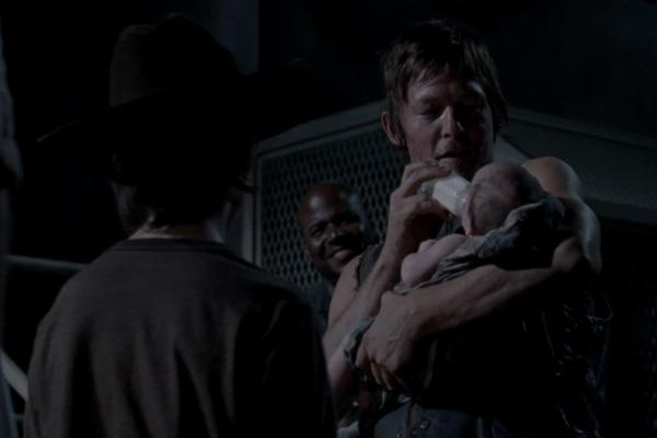 AMC The Walking Dead Melissa McBride as Carol Pelletier and Norman Reedus as Daryl Dixon holding baby Judith Lil Asskicker