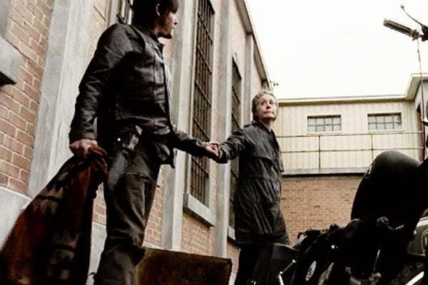 AMC The Walking Dead Melissa McBride as Carol Pelletier and Norman Reedus as Daryl Dixon motorcycle