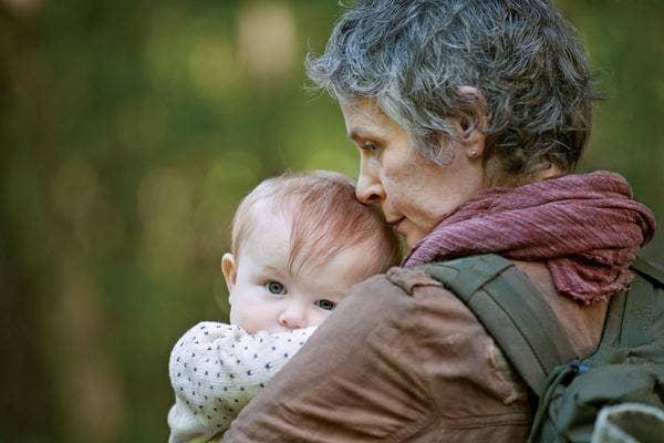 AMC The Walking Dead Melissa McBride as Carol Pelletier and Norman Reedus as Daryl Dixon baby Judith