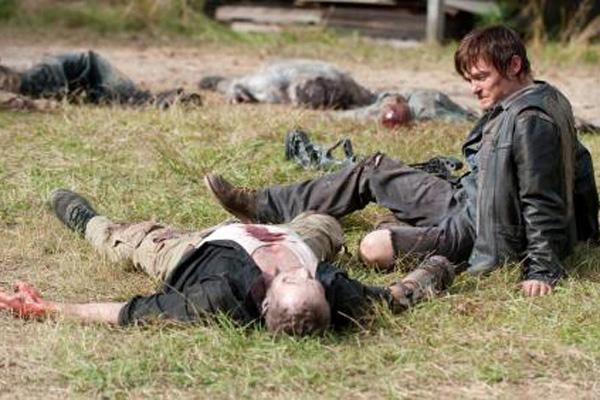 Daryl Dixon (Norman Reedus) and Merle Dixon (Michael Rooker) on 'The Walking Dead' where Daryl cries upon finding Merle dead and turned into a walker AMC
