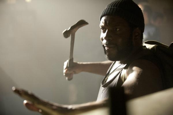 Chad L. Coleman as Tyreese on AMC 'The Walking Dead' holding a hammer