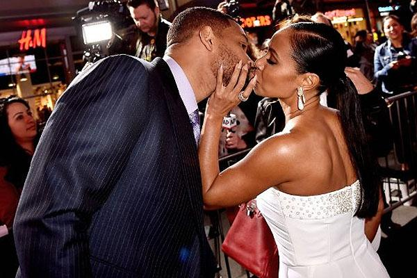Will Smith and Jada Pinkett Smith kissing at the Los Angeles premiere of Focus