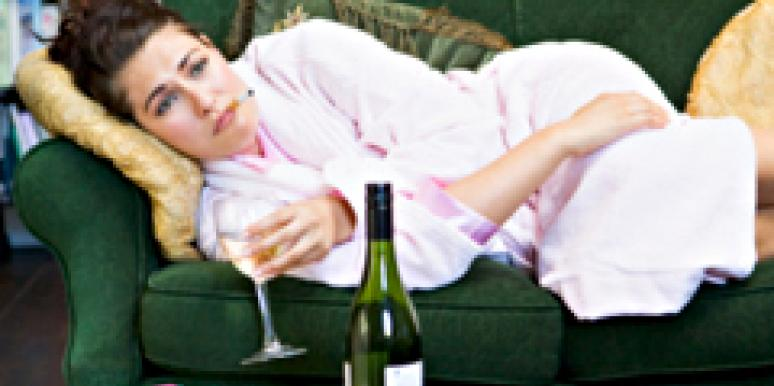 Woman drinking wine on couch