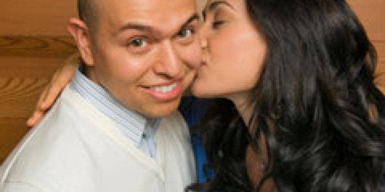 bald man with girlfriend