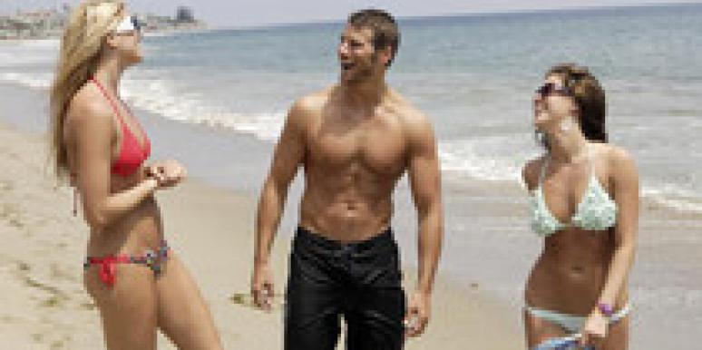 brad womack the bachelor with two ladies on the beach
