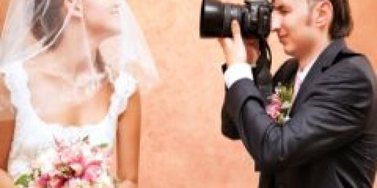 bride posing for wedding pictures with wedding photographer