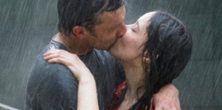 Couple kiss in the rain.