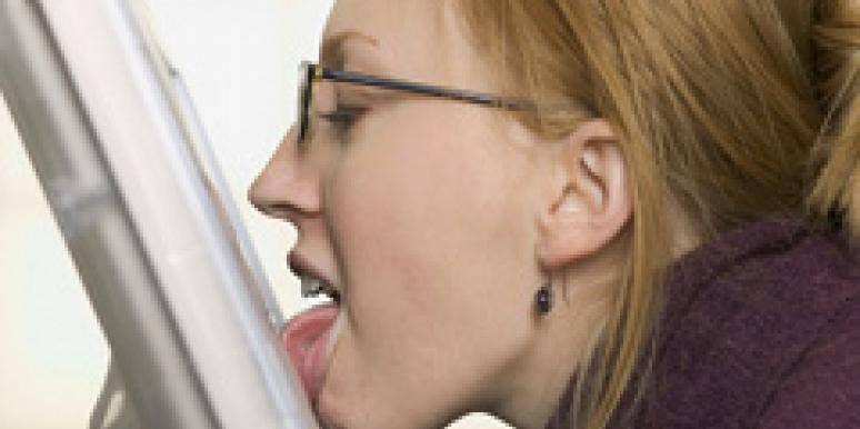 woman licking computer