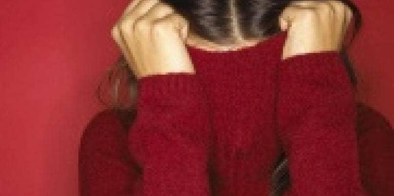 woman hiding in turtleneck