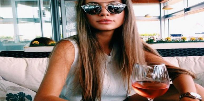 Woman with large glass of wine.
