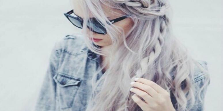 Woman with braid in her hair.